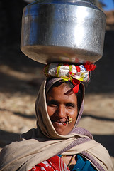 Water Carrier (cormend) Tags: portrait woman india water smile asia path jewelry jar jug nosering naturepreserve rajasthan carrying wildlifesanctuary nikond80 cormend
