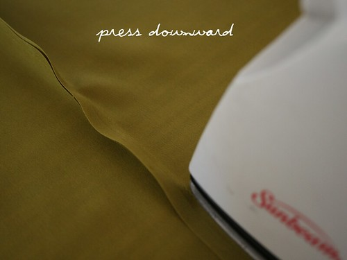 press downward
