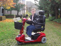 Glenda Watson Hyatt in her red mobility scooter