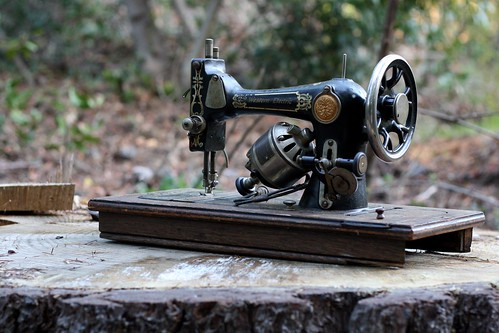 vintage sewing machine on a stump