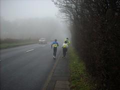 Running uphill in the fog