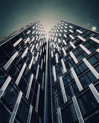 Beam Me Up (Philipp Klinger Photography) Tags: windows sky cloud reflection building me window glass up architecture clouds facade skyscraper reflections germany deutschland nikon shiny europa europe hessen cross pov frankfurt duo beam crossprocessing processing highrise architektur vignetting philipp vignette westend glas scraper xprocessing fassade hesse d300 klinger bockenheimer westendduo landstrase