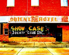 show case society club inc. (bluecinderella) Tags: show street door blue windows light red party urban music orange white black color colour brick green abandoned window beer glass colors alexandria grass lines yellow architecture club stars fun concrete star hotel la bottle weeds louisiana downtown colours notes bottles drink pavement decay south olive martini case line crack note sidewalk musical drinks abandon oriental mardigras orient society showcase inc decayed decaying buiding bluecinderella
