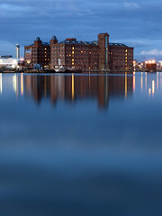 birkenhead dock (stevebates101) Tags: new old uk blue sunset water night wow lights dock britain 10 great olympus explore birkenhead greatshot faves wirral onblue eow abigfave e410 wowiekazowie excapture peachofashot