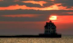 Lorain Lighthouse (teacherholly) Tags: sunset red orange cloud sun lighthouse lake water ball fire pier soft lakeerie action lorainlighthouse lorainohio milelongpier softposterizeaction