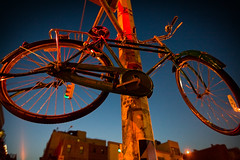 Tied up (emptysquare) Tags: street city nyc newyorkcity blue red urban ny newyork color lamp bike bicycle digital dark weird lock manhattan surreal wideangle chain lamppost bowery locked chained