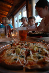 Dinner at the old Mill Wharf restaurant: Pizza! (Chris Devers) Tags: ocean sea food water kitchen cheese dinner bread ma restaurant harbor store italian eating massachusetts tomatoes cook pizza eat maritime meal dining nautical dine 2008 bake tomatosauce calzones calzone scituate bostonist scituateharbor cameranikond50 scituatema exif:focal_length=18mm exif:exposure=0033sec130 exif:aperture=f35 publicradiokitchen exif:exposure_bias=06ev camera:make=nikoncorporation exif:iso_speed=560 camera:model=nikond50 meta:exif=1257956569 exif:filename=dscjpg exif:orientation=rotated90degreescounterclockwise meta:exif=1350406871