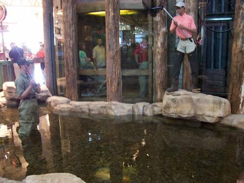 Men fishing in pond (mannequins)