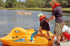 A helping hand (Poopshe_Bear) Tags: summer vacation lake water hat boat fishing pond sister brother paddle help teenager float paddleboat pedal helping pedalboat flotation