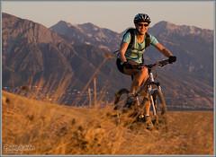 Bonneville Shoreline Trail (Photo-John) Tags: sunset woman mountain mountains sports girl smile bicycle cycling utah healthy wasatch outdoor femme mountainbike olympus saltlakecity mtb fitness wasatchfront evolt fourthirds 18180mm bonnevilleshorelinetrail e520 jennicurtis