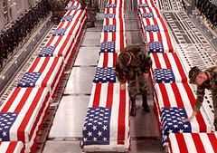 Image of flag draped caskets coming home from Iraq