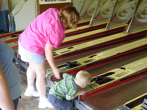 Nate playing Skee ball with Aunt amy