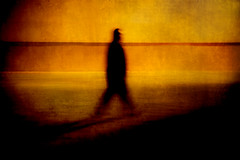 stride (wizmo) Tags: orange blur silhouette yellow night walking stride striding