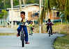 Peace (DSC3543) (Fadzly @ Shutterhack) Tags: life boys bicycle kids d50 fun nikon village play riding malaysia kampung terengganu nikonstunninggallery setiu penarik shutterhack sigma70200mmf28exdghsmapo