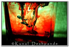 Poison Inky 1.... (Kunal Deshpande) Tags: red india green water glass backlight ink kunal deshpande nikond60