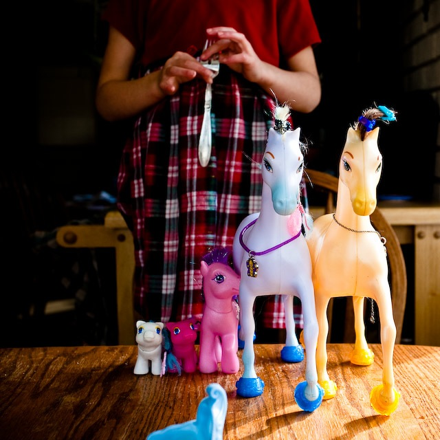 girl with toy ponies