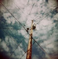 Electric Nexus (liquidnight) Tags: blue sky colour 120 film lines clouds mediumformat holga power pole powerlines electricity nexus holga120cfn 120cfn
