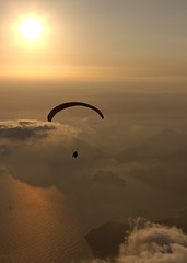 By the air Turkey (mark hunter images) Tags: uk sunset sky water silhouette canon turkey coast unitedkingdom dusk paragliding 2008 holidayactivities markhunter 40d eos40d