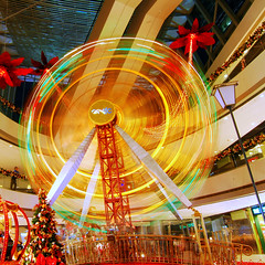 x'mas 2008  (rachelkwong) Tags: christmas xmas light motion colour movement nikon central tokina ferriswheel f28    hongkongphotos d80 abigfave aplusphoto ultimateshot 1116mm coloursplosion mallmixstaraward