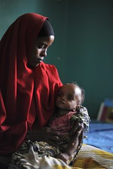 Bossaso: Life on the edge (UNHCR) Tags: africa portrait woman baby hospital children women infant child mother hijab son medical health hunger unhcr somalia hornofafrica displacement malnutrition idps idp puntland gulfofaden displacedpeople platinumheartaward bosasso unrefugeeagency eastandhornofafrica forciblydisplacedpersons bossasogeneralhospital