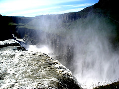 Mighty Gullfoss (little_frank) Tags: world above travel wild vacation panorama white mountains nature water beautiful beauty grass rock vertical wonderful river circle spectacular wonder landscape island gold freedom golden waterfall iceland islandia amazing fantastic scenery europe colours view natural north sunny canyon falls hills erosion falling fantasy whiteriver stunning gorge wilderness fabulous marvel northern foss majestic pure mighty gullfoss breathtaking impressive vapour majesty islande sensation marvellous spectacle breathless goldencircle mounts islanda primordial blueribbonwinner hvt fossen goldenwaterfall mywinners sland goldstaraward