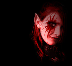 scarlet fever (whit_2_the_ney) Tags: red black rock scarlet eyes punk elf fairy ear jagged faerie