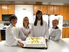Four Confirmands with Cake