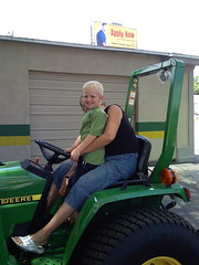 Grandma takes Zachary for a ride on the tractor