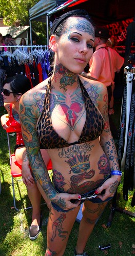 Funny bikini photo of Michelle Bombshell McGee with tattoos