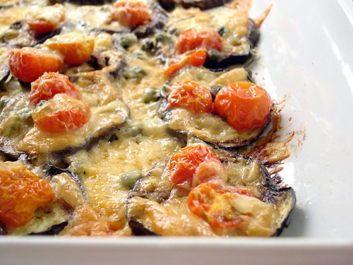Grilled eggplant with tomatoes and cheese
