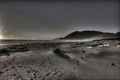Summer Fades (shetha) Tags: sunset sun sunlight mist mountain beach water oregon coast sand waves shadows lensflare flare handheld hdr beachscape photomatix nehalembay 3exposures 2ev 40d aperture2 canonefs1755mmf18is hdrcard fundprint
