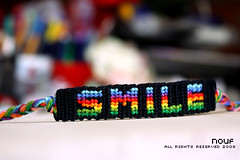 Smile,... (*glow) Tags: smile glow friendship handmade craft knot bracelet crafty knots 250 handcraft threads starlight knotted friendshipbracelet nouf reainbow colofgul