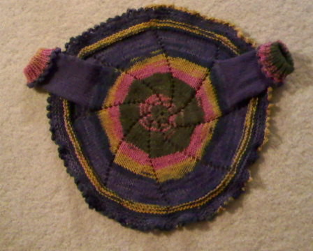 View of back of pinwheel sweater