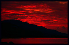 RED Sky (Kuzeytac) Tags: morning travel red sea sky cloud sun black color colour reflection nature wet silhouette backlight sunrise geotagged scenery view postcard aegean scene explore backlit geotag siluet deniz sabah leyla bulut gkyz ege manzara gne lsi yansma tekne k krmz doa tabiat siyah gndoumu canoneos400d canoneosdigitalrebelxti rainbowseries flickrchallengewinner kuzeytac copyrightedallrightsreserved aqualityonlyclub