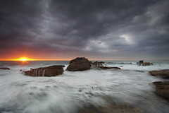 The Fighting Sun (Tim Donnelly (TimboDon)) Tags: ocean sea seascape sunrise rocks sydney australia nsw cokin bungan bestofaustralia