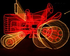 Zoomed Lighted Tractor Display - explore (Marvin Bredel) Tags: christmas tractor oklahoma night lights zoom noflash christmaslights explore kingfisher holidaylights soe marvin zoomeffect interestingness82 i500 marvin908 canon40d kingfisherinlights thegalleryoffinephotography lightedtractor bredel marvinbredel