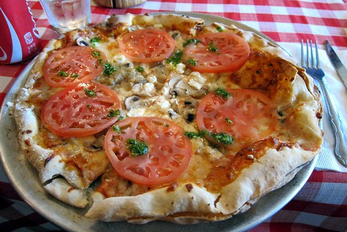 La Chevre: tomato, cheese, goat cheese, fresh tomato, caramelized onions, mushrooms