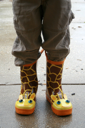 blue school boy cold silly wet rain weather kids umbrella children holding funny day boots clothes rainy giraffes dressed embarrassed