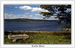 Sit and Ponder (DDA / Deljen Digital Art) Tags: uk england sky cloud lake mountains colour water grass seat northumberland stonebench kielder kielderwater kielderforest