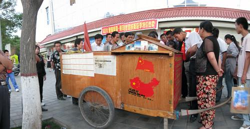 Human powered caravan of Chinese man walking around China (Jiuquan, Gansu Province, China)