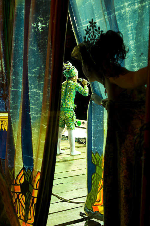 A performer waiting to go onstage at a likay performance, Kamphaeng Phet