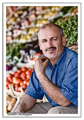 Veggie Man (Khalid AlHaqqan) Tags: blue portrait man vegetables shirt canon bald vegetable kuwait khalid seller shuwaikh 70200mm irani 40d alhaqqan