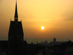 Strasbourg Sunset (Mike G. K.) Tags: city light sunset orange sun france mountains church window hotel golden warm tramonto view rooftops silhouettes roofs strasbourg alsace ibishotel bouncingball goldstaraward grouptripod placedehalles mikegk:gettyimages=submitted