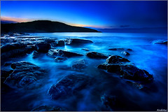 Pre Dawn (andrewwdavies) Tags: longexposure blue sea cold water sunrise dark geotagged fun still cool rocks earlymorning explore tones slippery verycold southerndown circularpolariser wetfeet canonefs1022mmf3545 explored dunravenbay glamorganheritagecoast wfcmeet canoneos40d mistywater andrewwilliamdavies witchspoint geo:lat=51446351 geo:lon=3606176