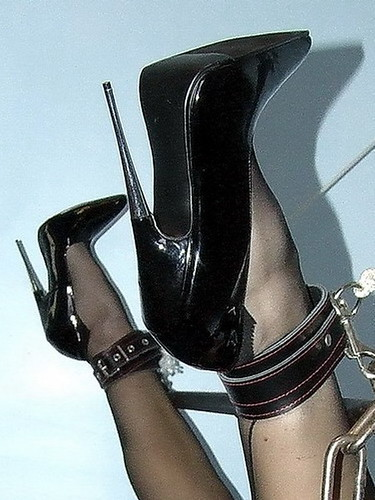High heeled woman in bondage