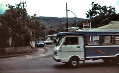 gm_00222 Tahiti Papeete Le Truck 1983 (CanadaGood) Tags: pacific tahiti papeete analog truck 1983 slidefilm tahitian kodachrome slidecube colour color bus canadagood gasstation sign tree vehicle eighties text