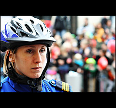 Bobby on the Beat Bokeh (Rben) Tags: blue people woman sinterklaas bike bicycle audience bokeh helmet police naturallight policewoman stnicholas officer almere policeofficer almerehaven hbw fab40 postedin2008 fab40dec2008