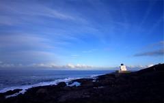 Streaks around a lighthouse (Chris H Photography (Back after a long absence)) Tags: light sea sky house beach clouds rocks streaks bamburgh