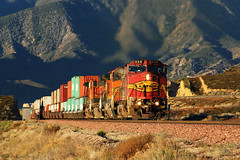 Warbonnet in Early Morning Light (K-Szok-Photography) Tags: california mountains canon outdoors socal canondslr soe bnsf locomotives cajon railroads inlandempire cajonpass alltrains platinumphoto movingtrains diamondclassphotographer flickrdiamond deserttrains sbcusa theenchantedcarousel kenszok