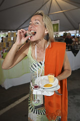 Guest savouring her food at Toronto Taste (Second Harvest) Tags: toronto ontario canada landscape sebastian photos fineart harvest event second taste 2011 photogarpher secondharvest petrescu torontotaste